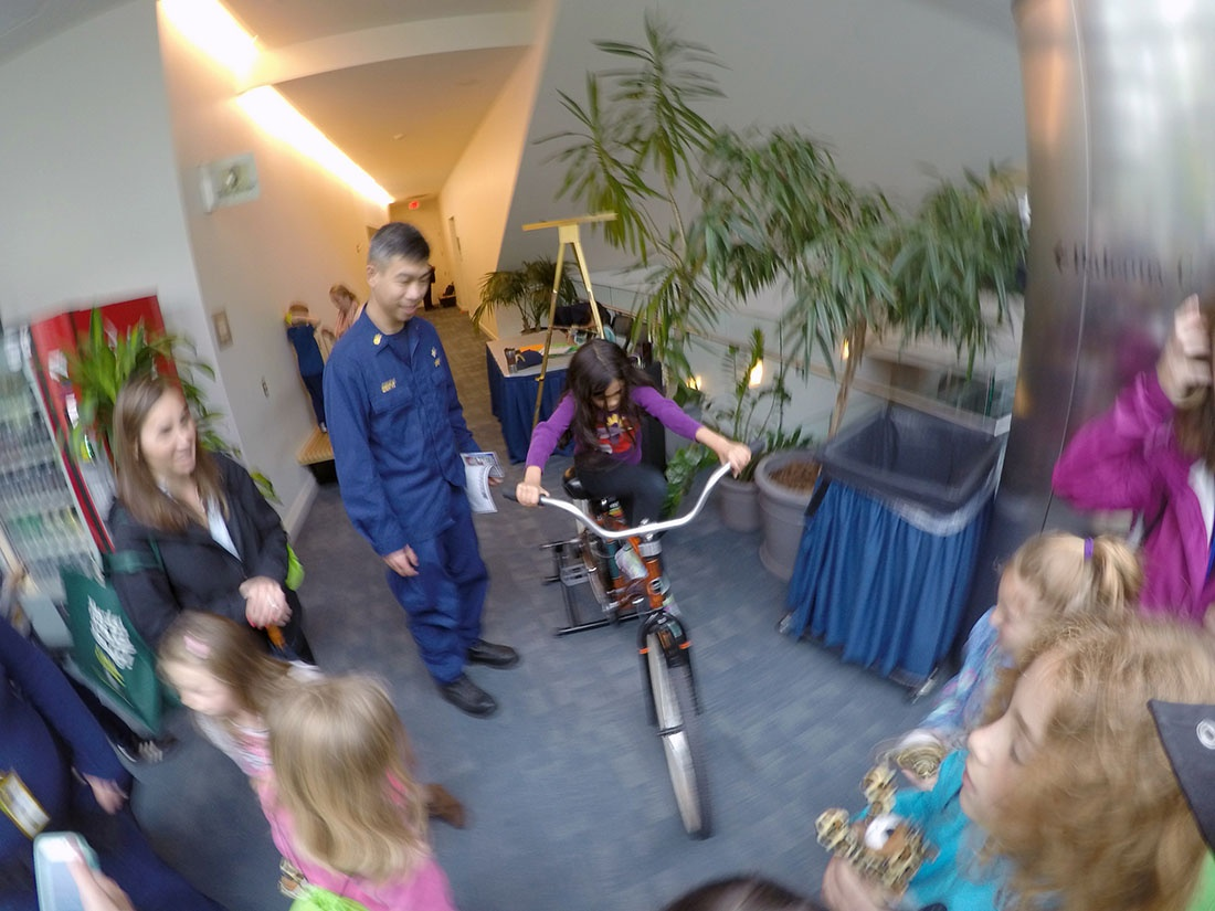 A young girl tests out a bicycle at the NIH Earth Day event