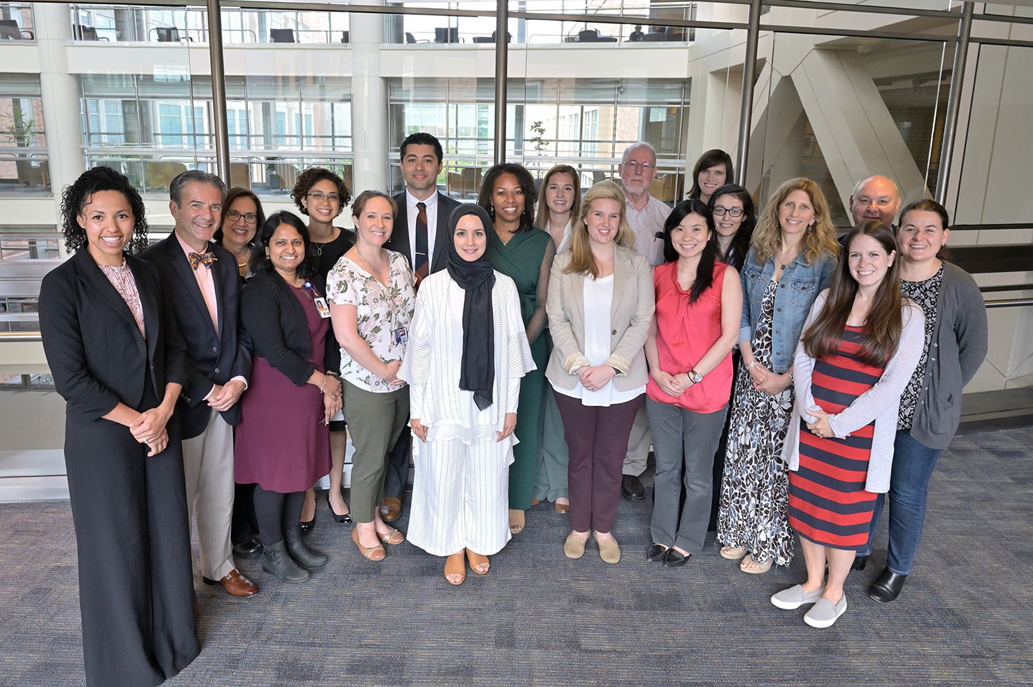 Fellows and faculty group photo in the Clinical Center atrium