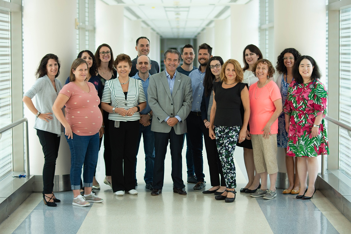 The Stratakis lab smiles for the camera in a well-lit Clinical Center hallway