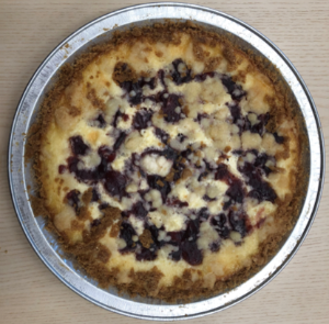 Mottled cheesecake and cranberry-topped pie