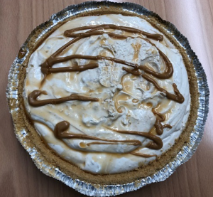 Creamy pie topped with chocolate and peanut butter drizzles