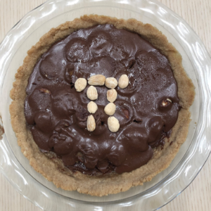 Chocolate pie topped with nuts in the shape of the pi symbol