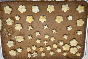 Rectangular pie with flower-shaped cutouts on top