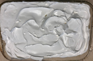 Rectangular pie with white cream topping