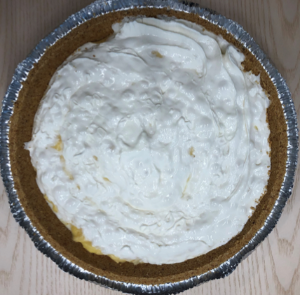 White creamy pie with bits of pineapple