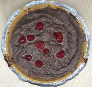Chocolate pie with cherries scattered on top